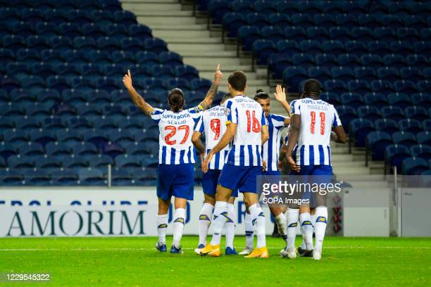 Porto's team players celebrate a goal during the match between FC Porto and Portimonense for the Portuguese First League at Dragon Stadium. .
