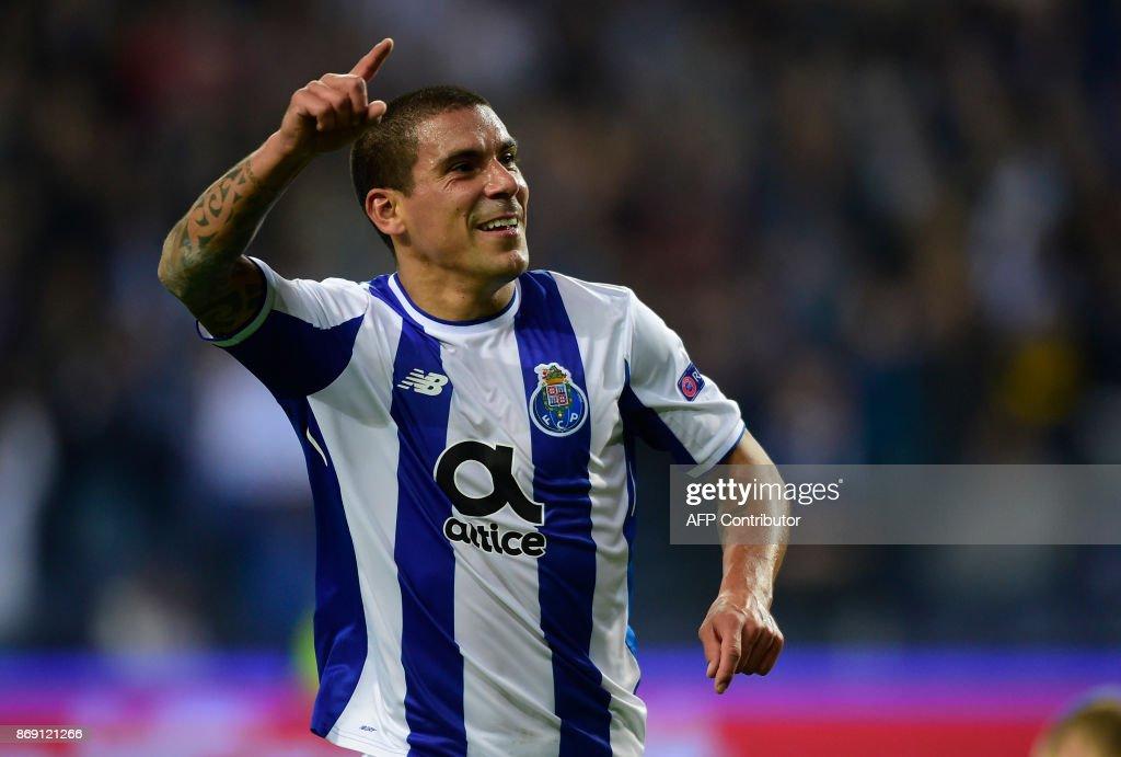 Porto's Uruguayan defender Maxi Pereira celebrates after scoring a goal during the UEFA Champions League group G football match FC Porto vs Leipzig at Dragao stadium in Porto on November 1, 2017. /