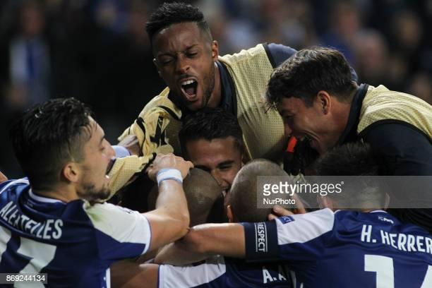 Porto's Uruguayan defender Maxi Pereira celebrates after scoring goal with teammates during the UEFA Champions League Group G match between FC Porto...