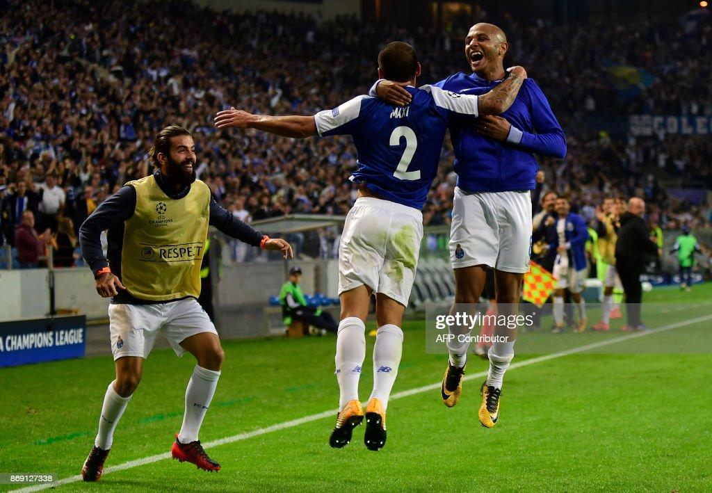 Porto's Uruguayan defender Maxi Pereira (C) celebrates with teammates after scoring his team's third goal during the UEFA Champions League Group G football match FC Porto vs Leipzig at Dragao stadium in Porto on November 1, 2017. /