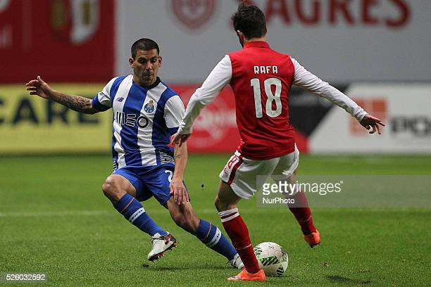 Porto's Uruguayan defender Maxi Pereira with Braga's Portuguese midfielder Rafa Silva during the Premier League 2015/16 match between SC Braga and FC...