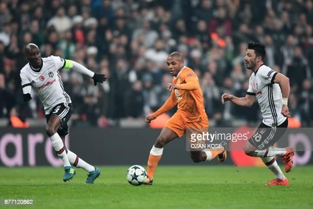 Porto's Yacine Brahimi vies for the ball with Besiktas' Atiba Hutchinson and Tolgay Arslan during the UEFA Champions League Group G football match...