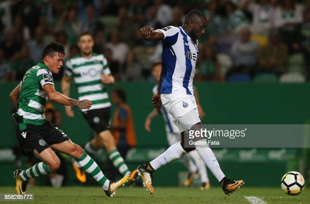Porto'u2019s forward Moussa Marega from Mali with Sporting CP defender Jonathan Silva from Argentina in action during the Primeira Liga match between...