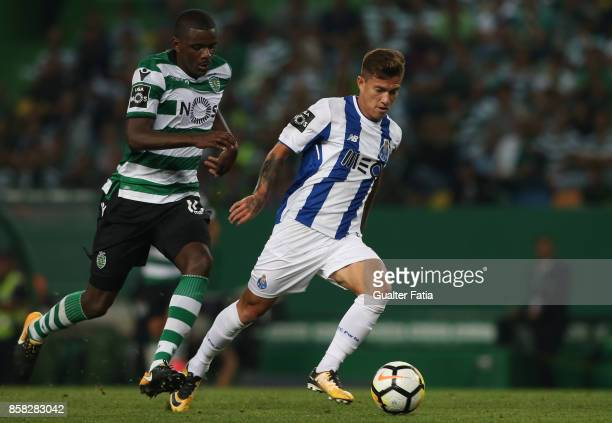 Porto'u2019s forward Otavio from Brazil with Sporting CP midfielder William Carvalho from Portugal in action during the Primeira Liga match between...