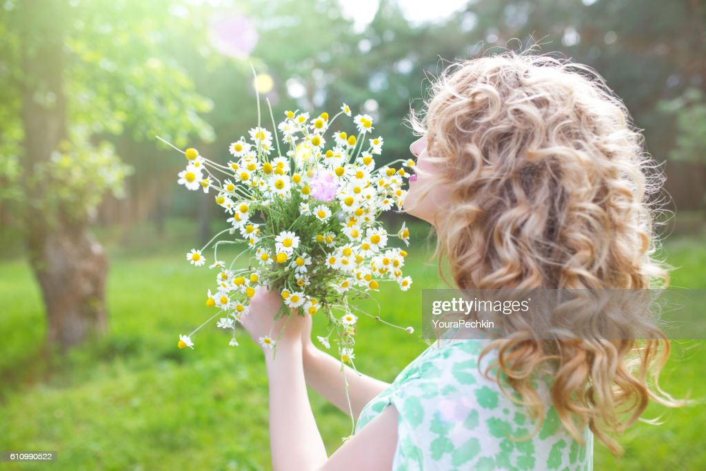 Portrait a girl with a bouquet : Stock Photo