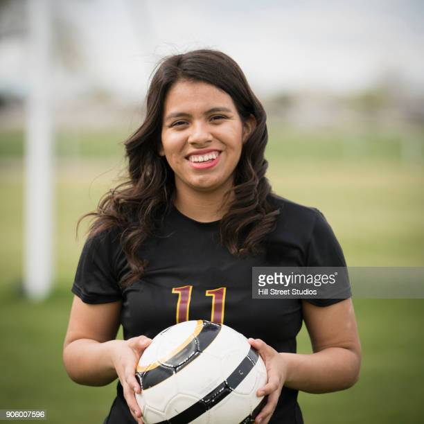 Portrait a smiling woman holding soccer ball