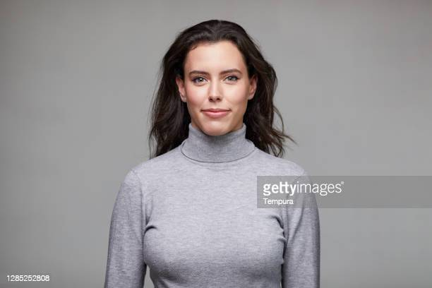 portrait a young businesswoman wearing a turtleneck sweater. - black hair stock pictures, royalty-free photos & images