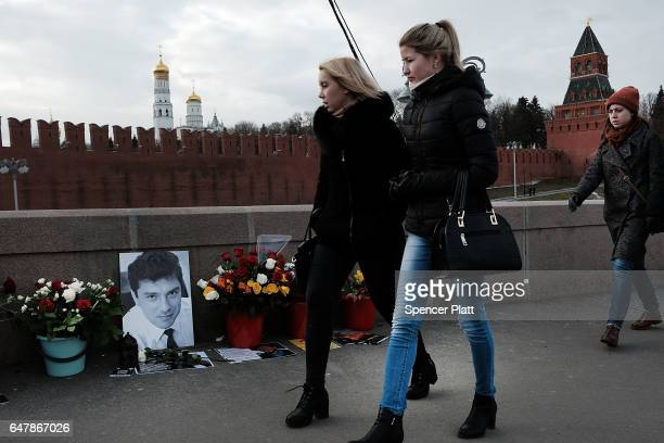 A portrait and flowers mark the spot where opposition leader Boris Nemtsov was gunned down near the Kremlin just over two years ago on March 4 2017...