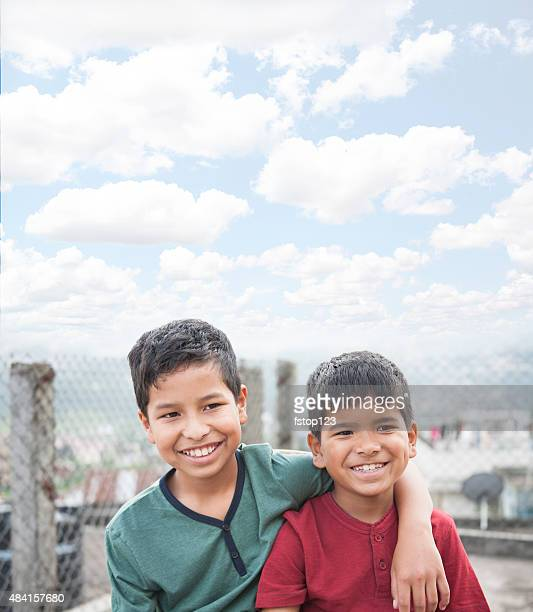Portrait. Asian boys in urban city streets. Smiling, happy.