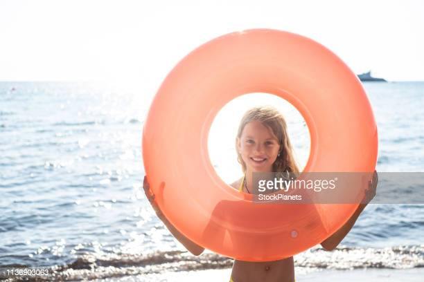 portrait beauty girl looking through floating ring - midsection stock pictures, royalty-free photos & images