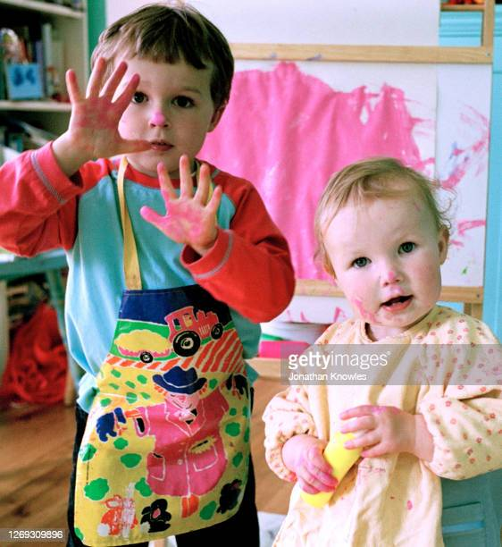 portrait boy and girl finger painting - craft stock pictures, royalty-free photos & images