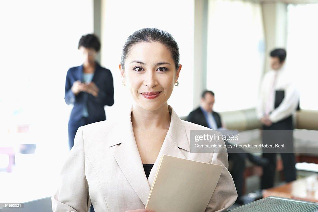portrait business woman holding document : Stock Photo