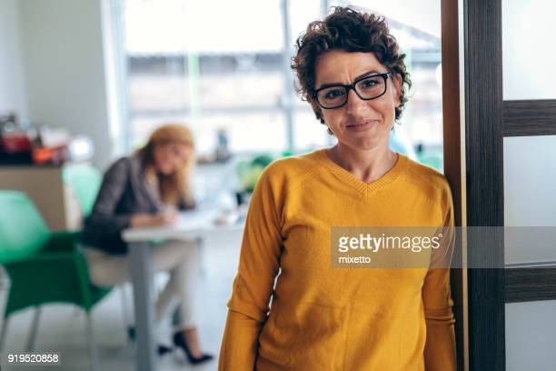 portrait business women  in the office - contented emotion stock pictures, royalty-free photos & images
