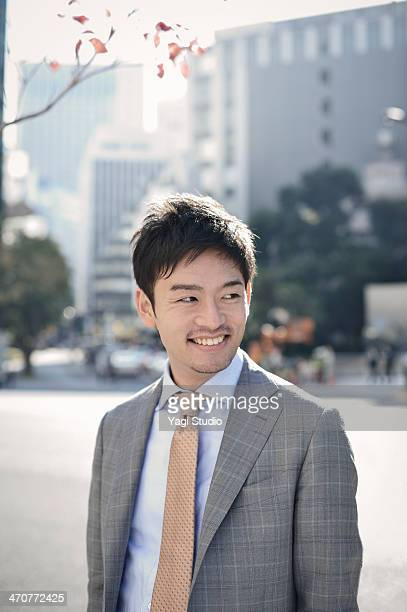 Portrait businessman in city