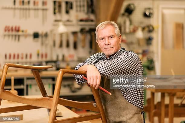 portrait carpenter in wood workshop