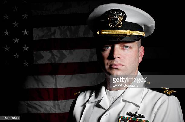 portrait caucasian sailor wearing white uniform  american flag background - navy stock pictures, royalty-free photos & images