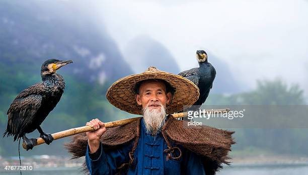 Portrait Chinese traditional fisherman with cormorants fishing, Li River China