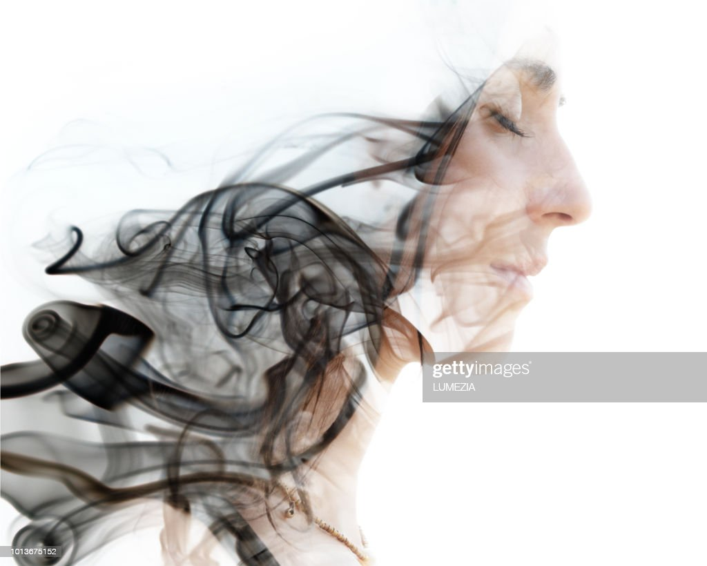 A portrait combined with a photograph of the smoke. : Stock Photo