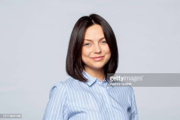 portrait confident brunette businesswoman - blouse stock pictures, royalty-free photos & images