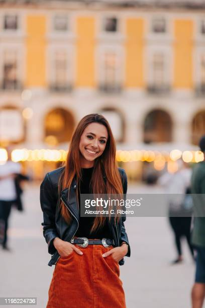 portrait confident young woman on urban street - three quarter length stock pictures, royalty-free photos & images