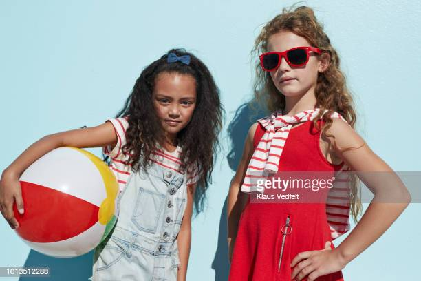portrait cool girls together on blue backdrop in summer - children only stock pictures, royalty-free photos & images