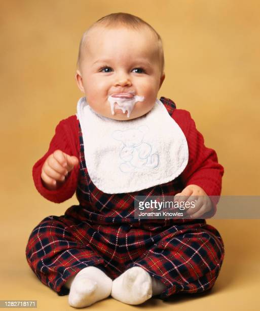 portrait cute baby dribbling food - one baby boy only stock pictures, royalty-free photos & images