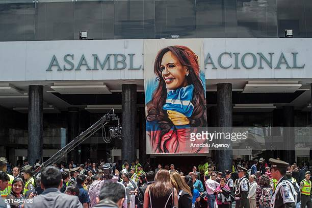 A portrait depicting Argentina's former President Cristina Fernandez hangs above the entrance of the National Assembly in Quito Ecuador Thursday Sept...