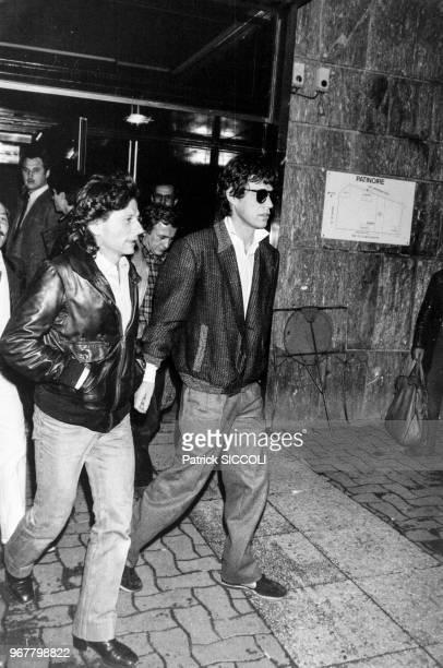 Portrait du réalisateur Roman Polanski et du chanteur anglais Mick Jagger lors d'une soirée de catch féminin au Krypton le 16 novembre 1982 à Paris...