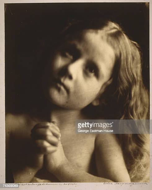 Portrait entitled 'Prayer' shows a little girl Elizabeth Keown as she clasps her hands and glances upwards Isle of Wight England mid 1860s