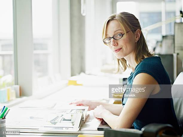 Portrait female architect at desk