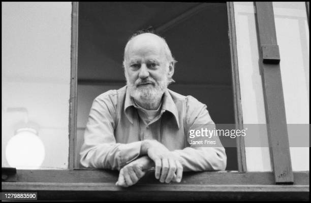 Portrait, from below, of American poet and activist Lawrence Ferlinghetti as he poses in a second floor window of the bookstore he co-founded, City...