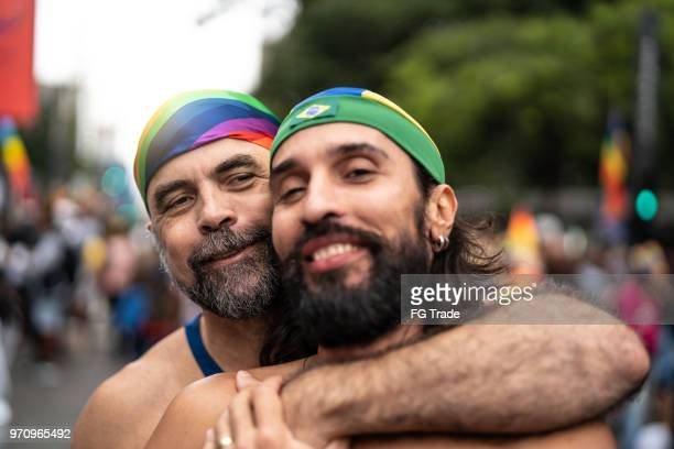 Portrait Gay couple celebrating on Gay Parade