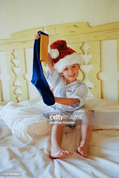 portrait happy boy at christmas - stockings photos stock pictures, royalty-free photos & images