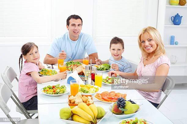 Portrait - happy family of four snack