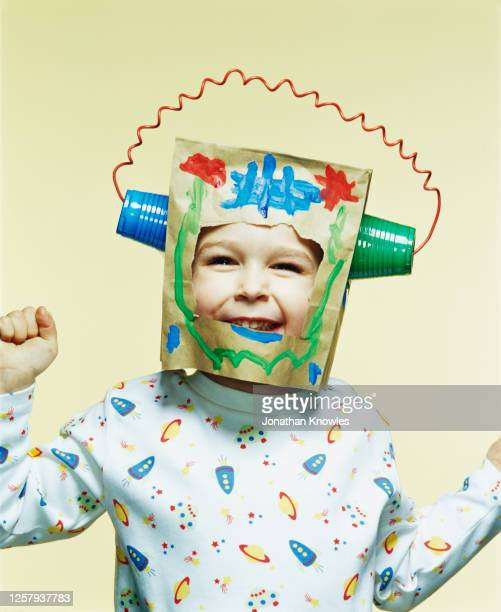 portrait happy space boy - robot stock pictures, royalty-free photos & images