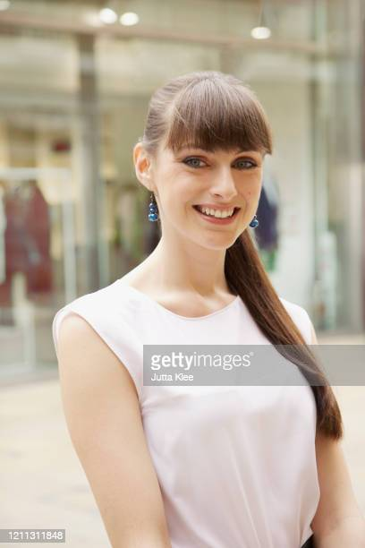 portrait happy young woman on sidewalk - sleeveless stock pictures, royalty-free photos & images