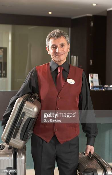 Portrait Hotel porter holding luggage
