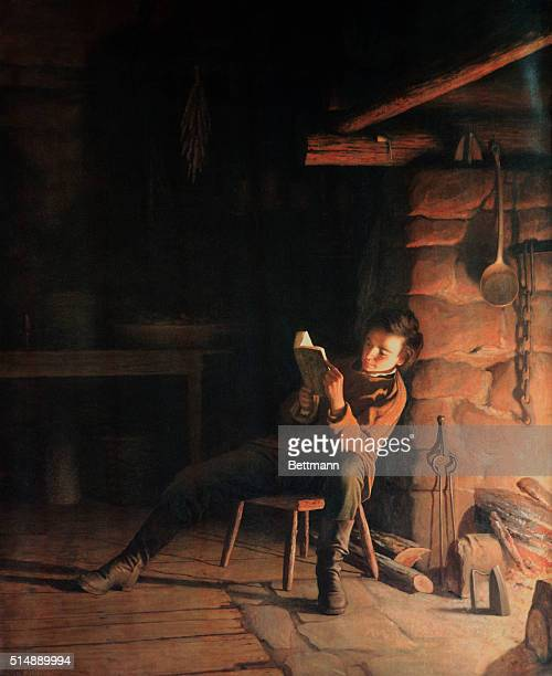 Portrait in oil entitled Boyhood of Lincoln depicting a young Abraham Lincoln reading by firelight