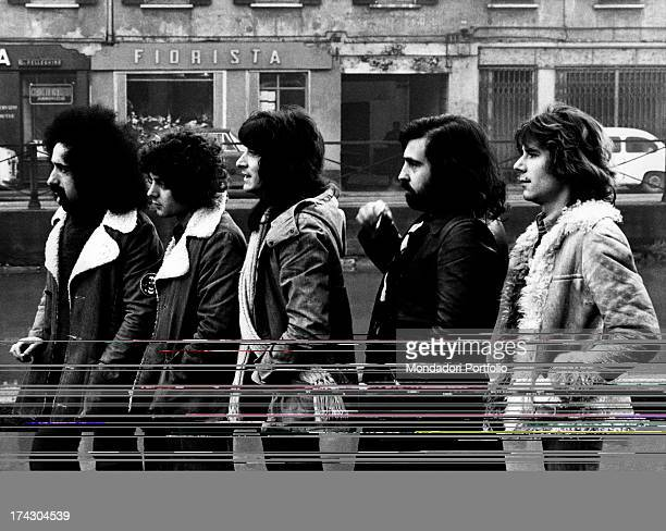 Portrait in profile of the Italian quintet I Camaleonti on a street of Milan from left Livio Macchia Antonio Cripezzi known as Tonino Dave Sumner...