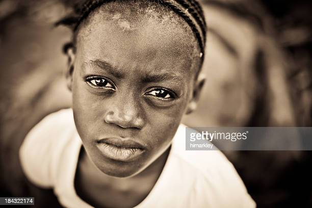 Portrait in sepia of an African girl with inquisitive eyes