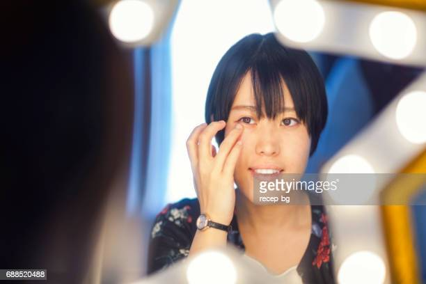 portrait in star shaped mirror - contacts stock photos and pictures