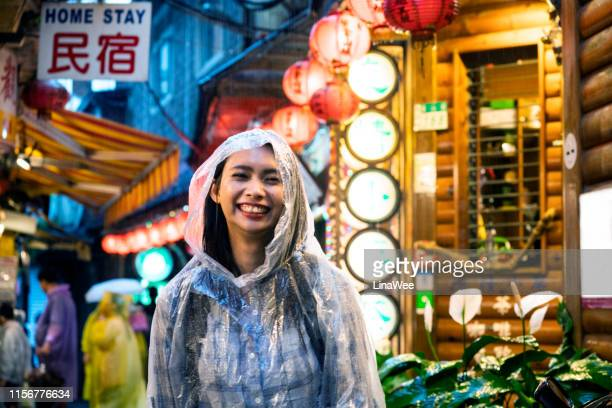 portrait in the rain - poncho stock pictures, royalty-free photos & images
