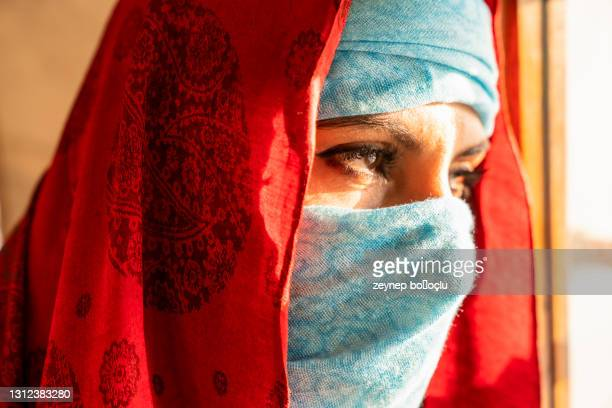 portrait in the shawl. east woman a portrait, young arabian woman in hijab with sexy black eyes - nikab stock pictures, royalty-free photos & images