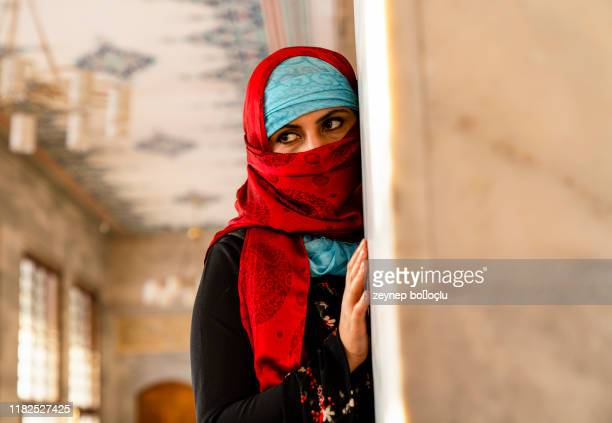 portrait in the shawl. east woman a portrait, young middle eastern woman in hijab with sexy black eyes. beautiful brunette woman in red and blue headscarf - traditional clothing stock pictures, royalty-free photos & images