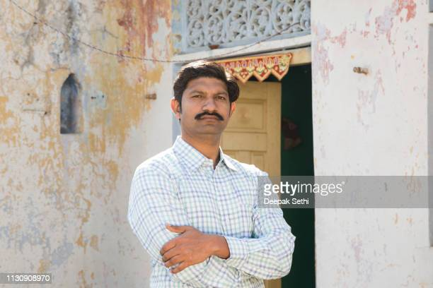 portrait indian man at village - stock image - village stock pictures, royalty-free photos & images