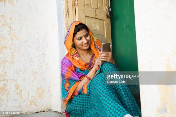 portrait indian woman in sari at village - stock image - village stock pictures, royalty-free photos & images