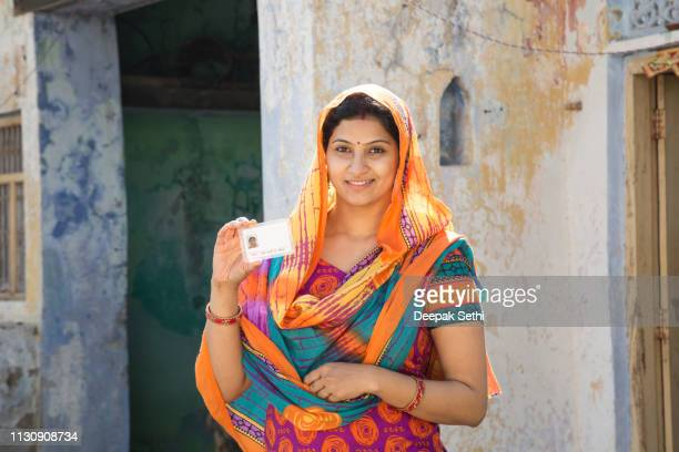 Portrait indian woman in sari at village - Stock image