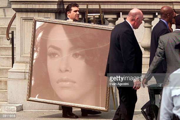 A portrait is taken out of R B singer Aaliyah's memorial service at St Ignatius Loyola Roman Catholic Church in New York City 8/31/2001 Photo Evan...
