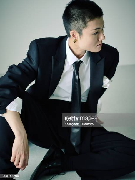 Portrait Japanese woman on mens suits with very short hair