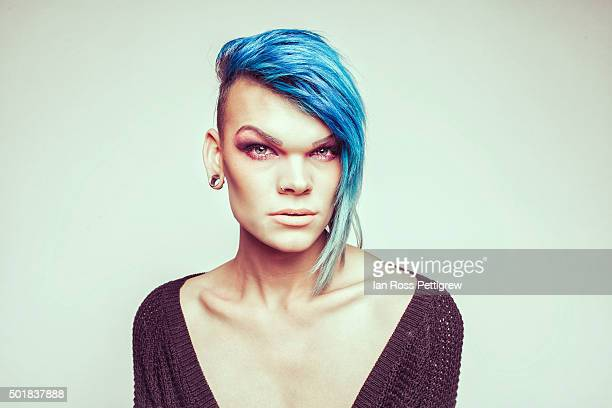 portrait, male transvestite with blue hair - transvestite stock photos and pictures